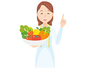 Illustration that a female nutritionist has vegetables - upper body