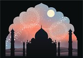 A view of the Taj Mahal under the moonlight and the starry sky framed through a doorway. The background is degraded in blue and orange tones with ornaments based on paisley patterns and persian tiling