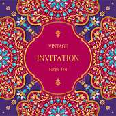 Indian wedding Invitation card templates with gold patterned and crystals on paper color Background.