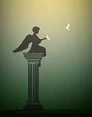 innocent kind, small girl angel sitting on the column and touching the white pigeon, one day of statue life
