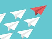 Unique red isometric paper plane and many white ones on turquoise blue sky. Leadership, teamwork and courage concept. Flat design. EPS 8 compatible vector illustration, no transparency, no gradients