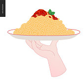 Italian restaurant set - a hand holding a plate with pasta and red bolognese sauce