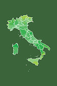 Italy watercolor map vector illustration in green color with border lines of different regions on dark background using paint brush