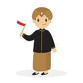 Javanese boy wearing traditional dress and holding Indonesian flag cartoon vector