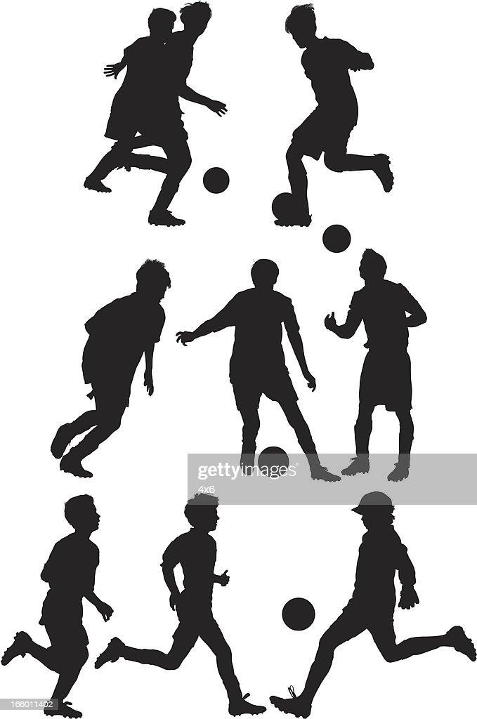 Kids playing soccer : Vector Art