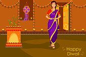 Lady with diya celebrating Diwali festival of India in vector