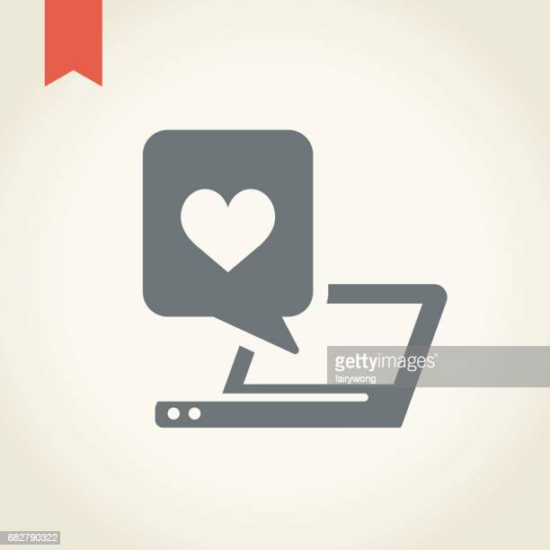 Laptop with heart icon