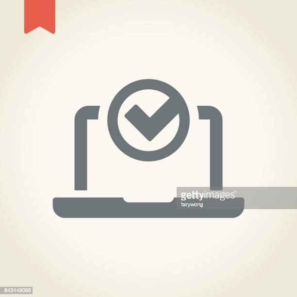 Laptop with tick mark icon