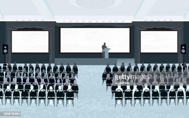 Ampia sala riunioni con oratore e tre schermi