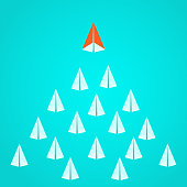Leadership concept. Orange paper airplane leader standing out from the crowd. Business advantage opportunities and success concept. Vector Illustration