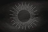 Light rays, sunburst and rays of sun on black chalkboard. Linear drawing. Vintage hipster style. Light rays sunburst for retro logo, emblem. Vector Illustration