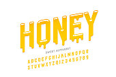 Liquid sweet honey font, alphabet letters and numbers vector illustration