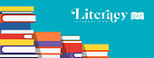 World Literacy Day web banner illustration of colorful school books for children education. EPS10 vector.