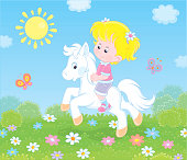 Cute smiling child on a small horse on a green field with flowers on a sunny day, vector illustration in a cartoon style