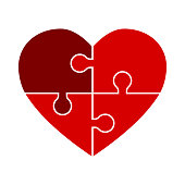 A vector heart that has been divided into four different puzzle pieces.