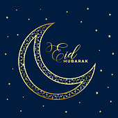 lovely golden decorative eid moon and stars background
