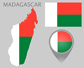 Colorful flag, map pointer and map of Madagascar in the colors of the Madagascar flag. High detail. Vector illustration