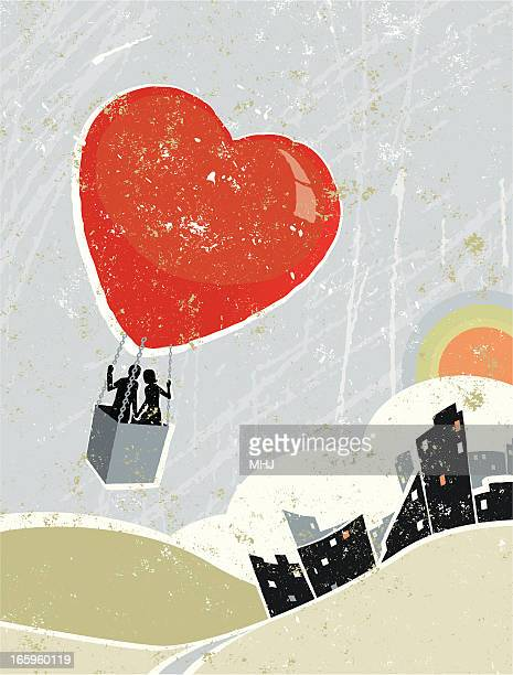 Man and Woman Flying in Heart Shaped Hot Air Balloon