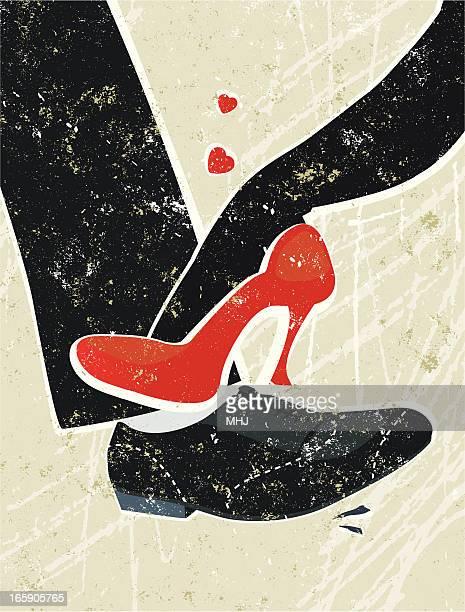 Man and Woman's Feet Playing Footsie