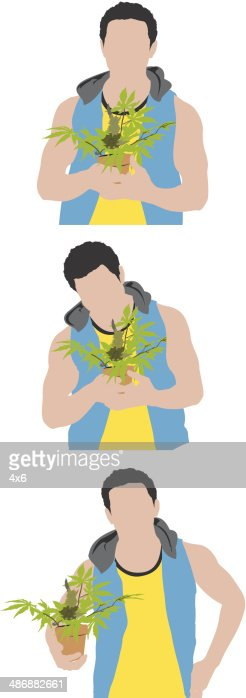 Man holding a pot with plant : Vector Art