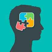 Silhouette of man head profile putting the puzzle pieces together, thoughts in brain concept, vector illustration