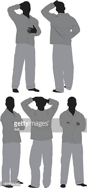 Man standing in pajamas