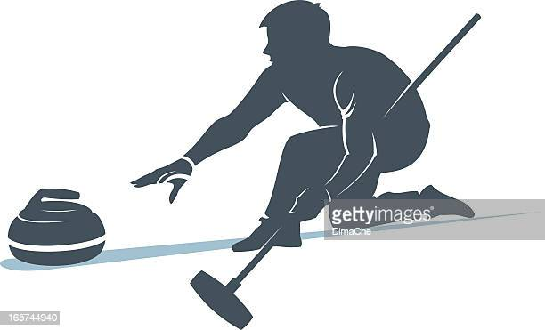 Man taking part in curling sport