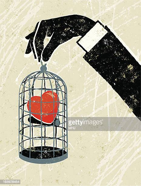 Man's Hand Holding Heart Trapped in a Birdcage