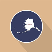 Map of the U.S. state of Alaska on a blue background. State name.