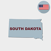 Map of the U.S. state of South Dakota on a grey background. American flag, state name