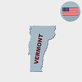Map of the U.S. state of Vermont on a grey background. American flag, state name