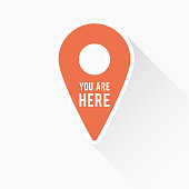 Map pointer icon with long shadow and the text 'You are here'. Concept of GPS, location, position, navigation, direction. Vector illustration, flat design