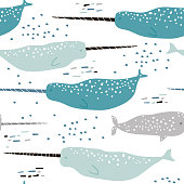Marine seamless pattern with hand drawn narwhals, Childish texture for fabric, textile, nursery, wrapping. Vector Illustration