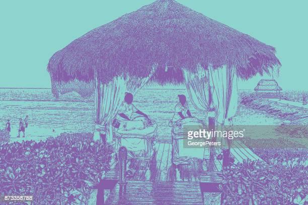 Maya massage im mexikanischen Touristenort mit Blick auf das Karibische Meer