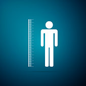 Measuring height body icon isolated on blue background. Flat design. Vector Illustration