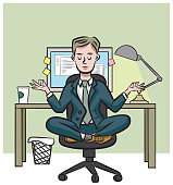 An office worker meditates in front of his desk.