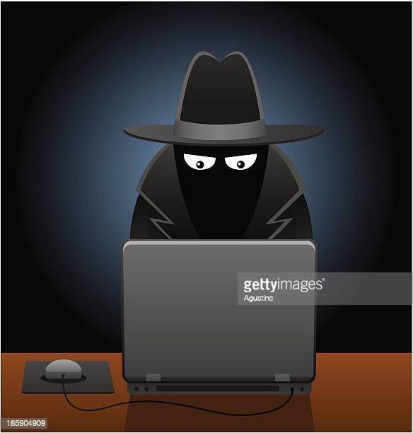 Men in Black Using Computer
