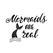 Mermaids are real. Inspirational quote about summer. Modern calligraphy phrase with hand drawn mermaid's tail. Simple vector lettering for print and poster. Typography design.