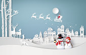 Merry Christmas and winter season,with Santa Claus and snow man. Paper art and craft style.