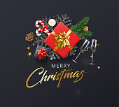 Black Merry Christmas greeting card with top view gifts, glasses and holiday decorations. Vector background.