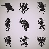 A collection of nine heraldic symbols black silhouettes in profile. From top left to right are ranked as follows vulture, dragon, bull,