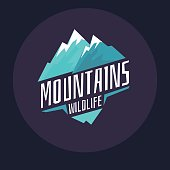 Modern emblem mountains with snow in the circle on a dark background. Vector image in flat cartoon style