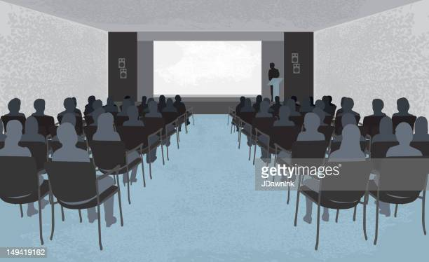 Monochrome drawing of lecture hall with audience