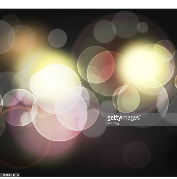 Montage of various sized circles dispersing colored lights