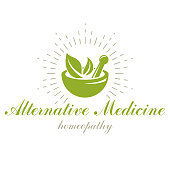 Mortar and pestle graphic vector symbol composed with green leaves. Homeopathy creative icon for use in medicine, rehabilitation or pharmacology.
