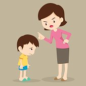Mother scolds her son.Mother angry at her son and blame him.Mom scolds children.