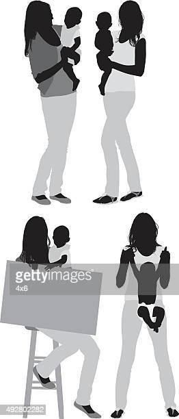 Madre con il figlio saldatura