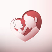 Mother holding a baby with her arm in heart shaped silhouette in paper art style