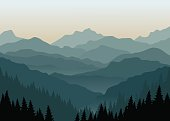 Vector illustration of a misty sunrise in the mountains. Layered mountain ranges in the fog. Eps 10.