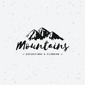 Vector mountains emblem. Outdoor activity symbol. Mountain Hand Drawn Logo.